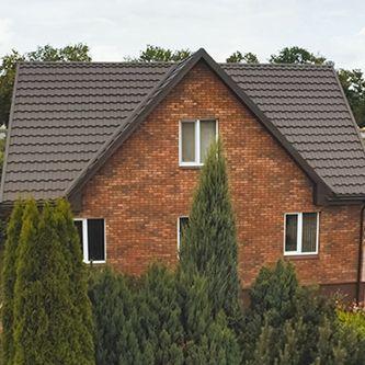Dark brown metal roof on brick home